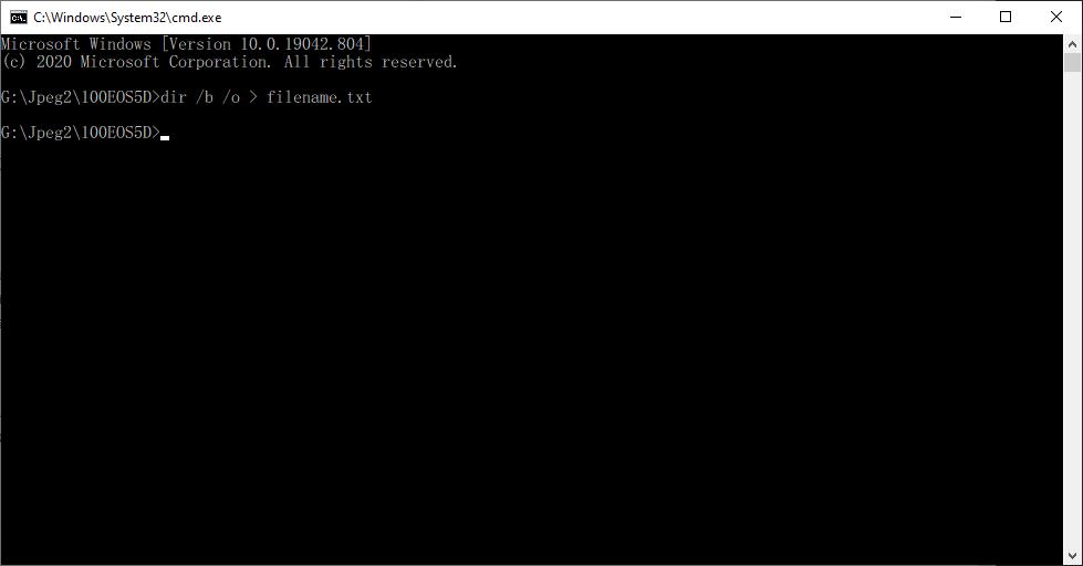 แสดงการใช้คำสั่ง DOS เพื่อดึงรายชื่อไฟล์ทั้งหมดในโฟลเดอร์เข้าไปในไฟล์ที่ต้องการ